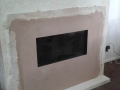 Small limestone hearth is fitted