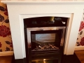 Blanco marble with black granite fireplace
