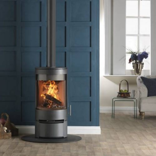 Purevision PVR cylinder multi fuel stove on log store